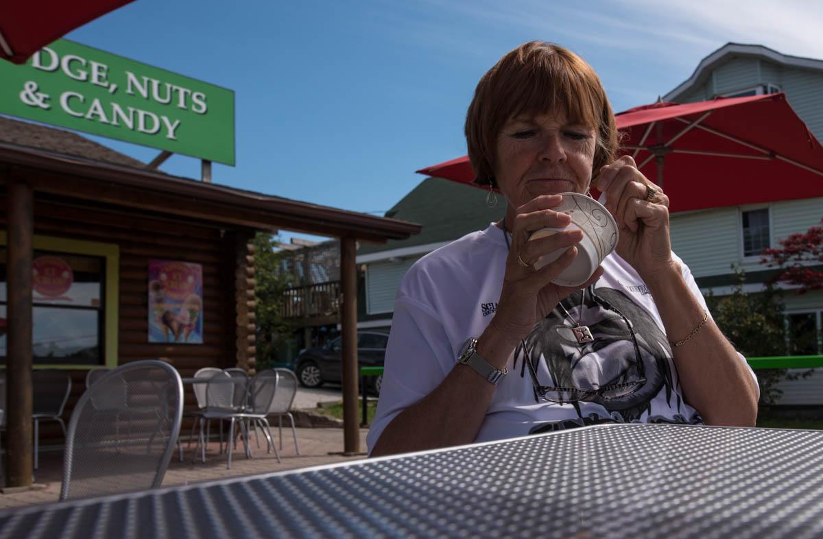 Carol enjoys her ice cream at the Sweet Shop