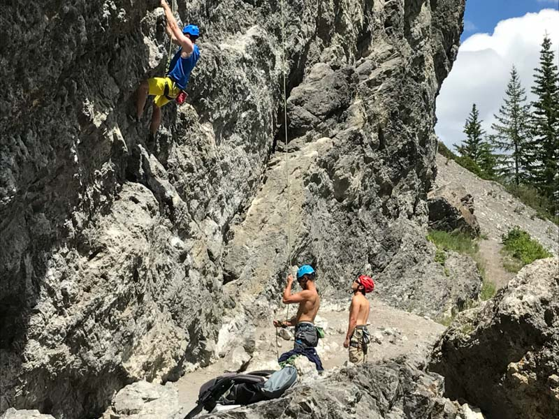 rock climbers at the top of the grassi trail