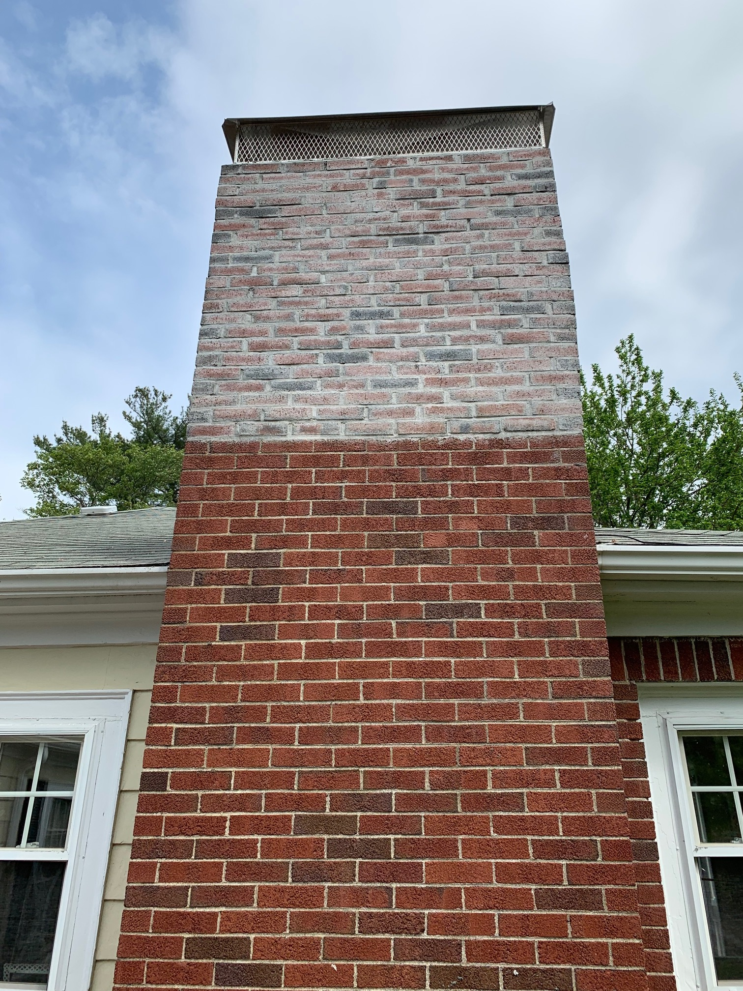 They sealed it with a sealer, locking the film of white in the brick!!! And it's crooked!
