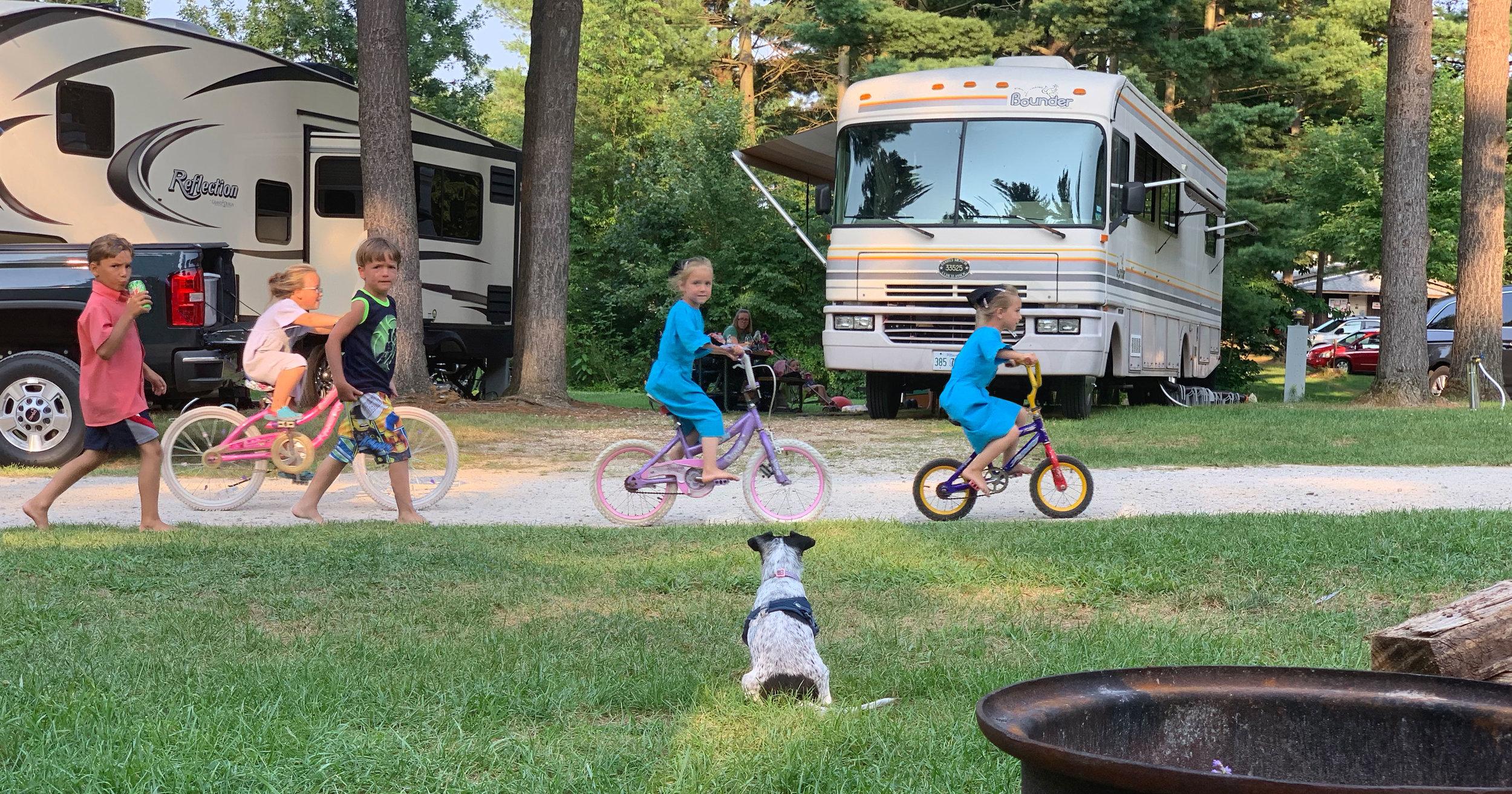 Amish kids on bikes.