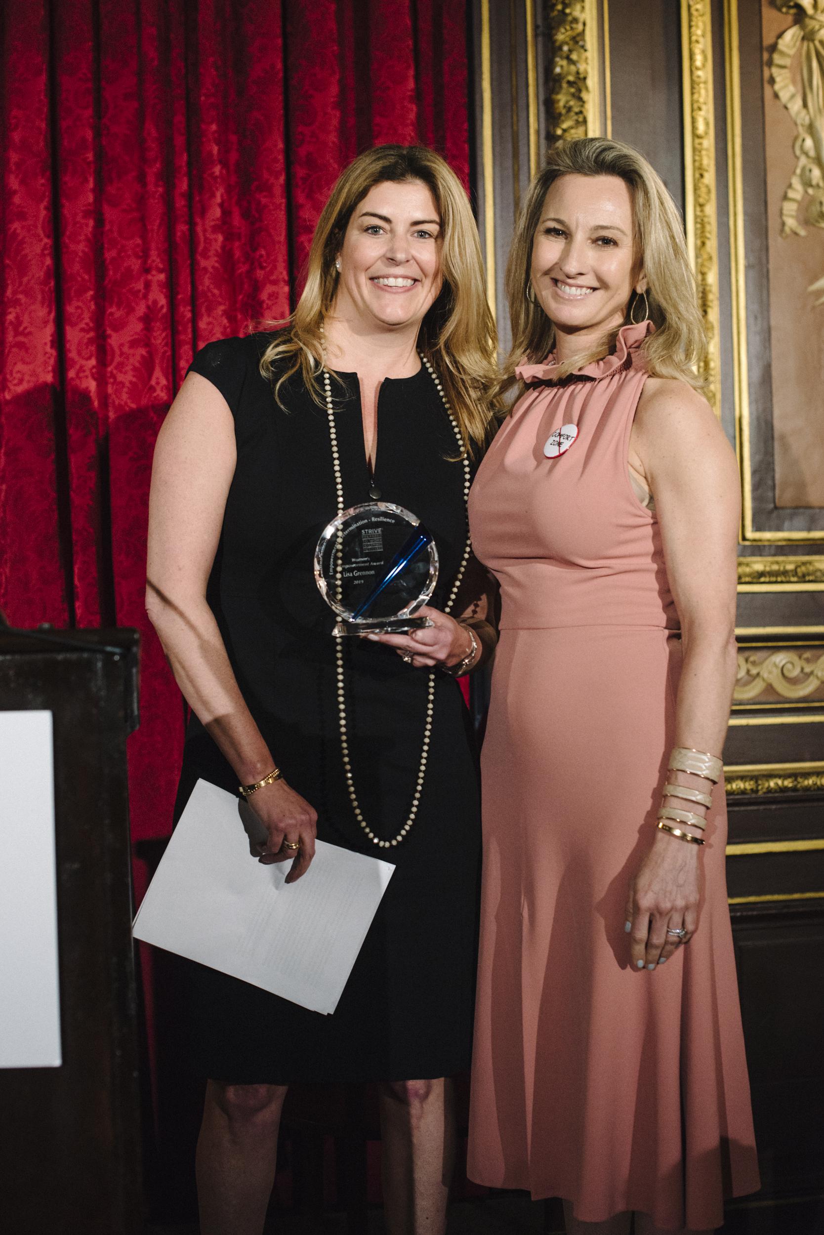 Lisa Tonia with Award.jpg