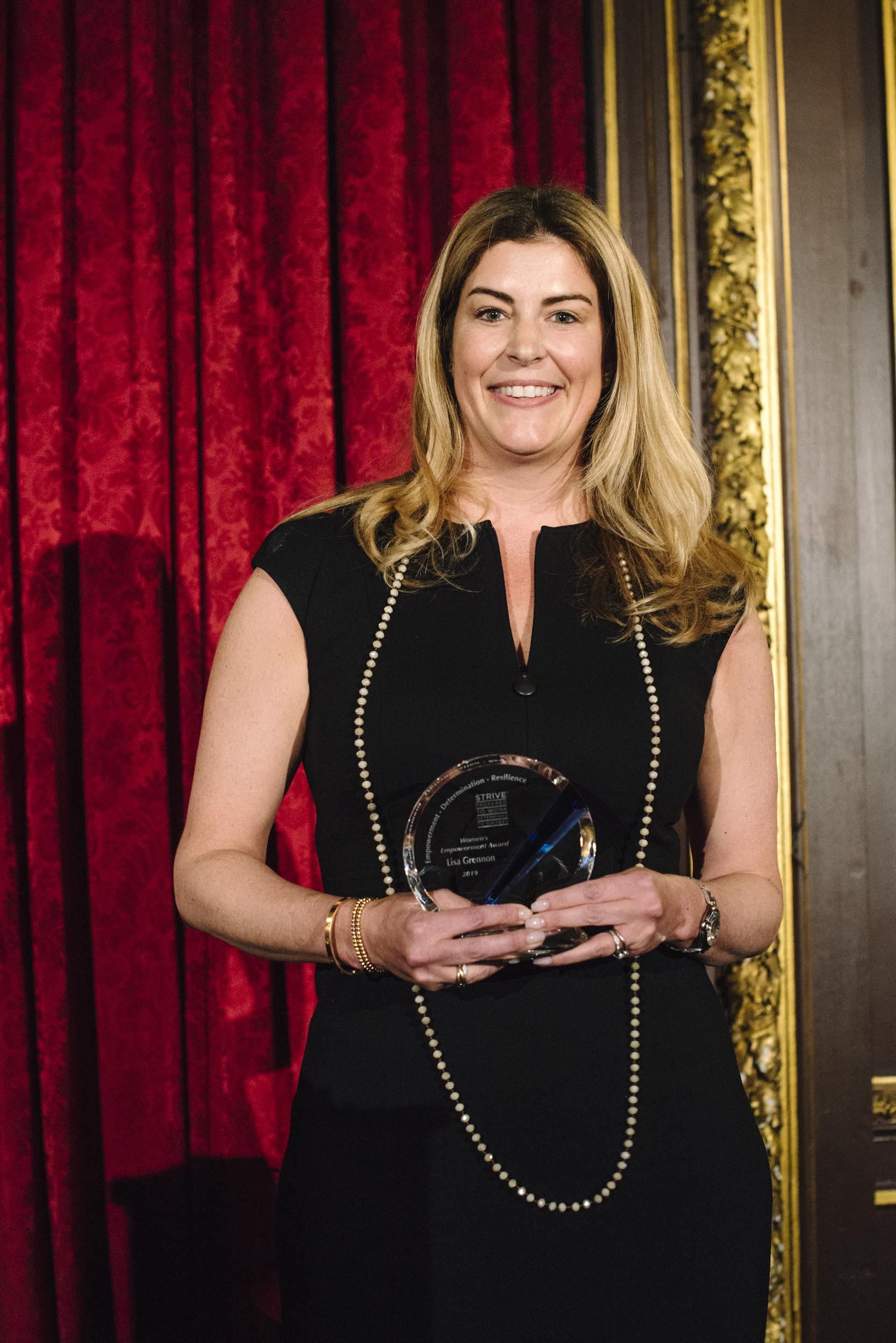 Lisa with Award - Copy.jpg