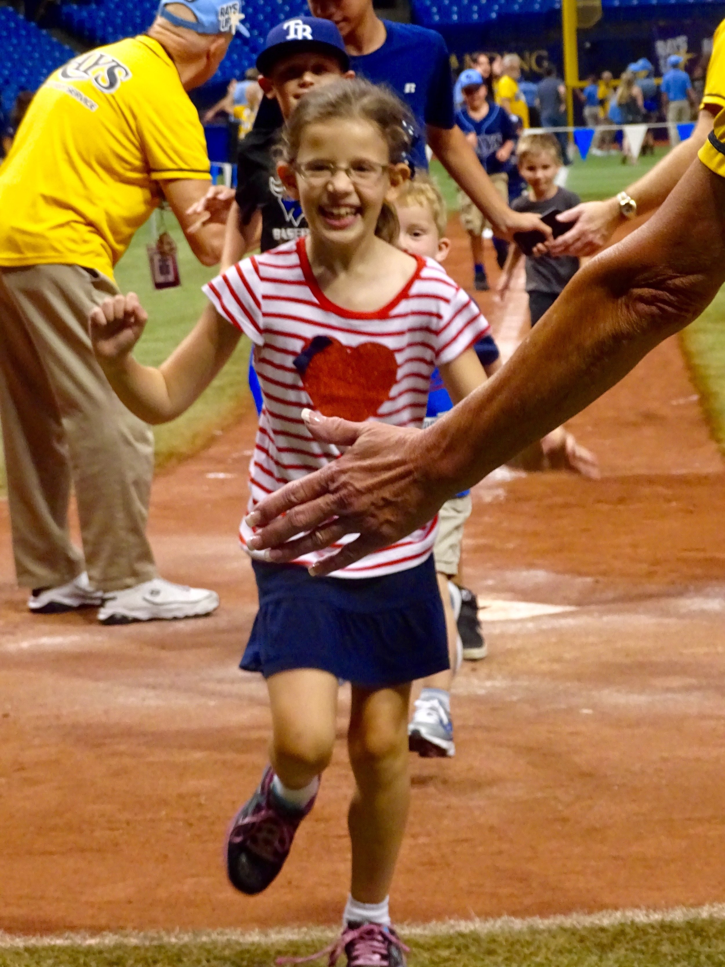 Our daughter running to home plate at Marlins Park in Miami, Florida.