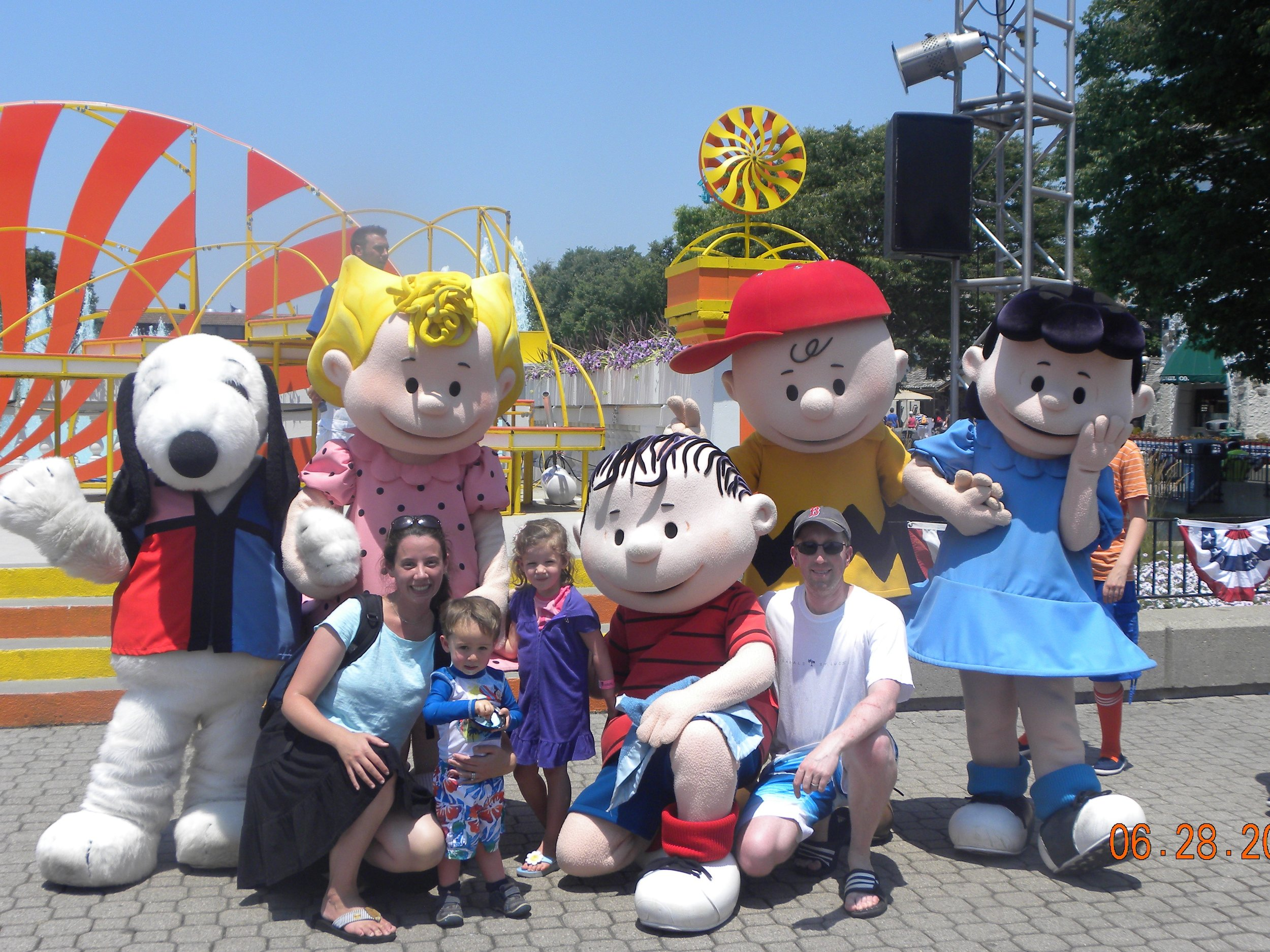 My family after a dance party with Snoopy and the gang at King's Island, outside Cincinnati, Ohio in 2012. This was one of the first stops on our first, big road trip.