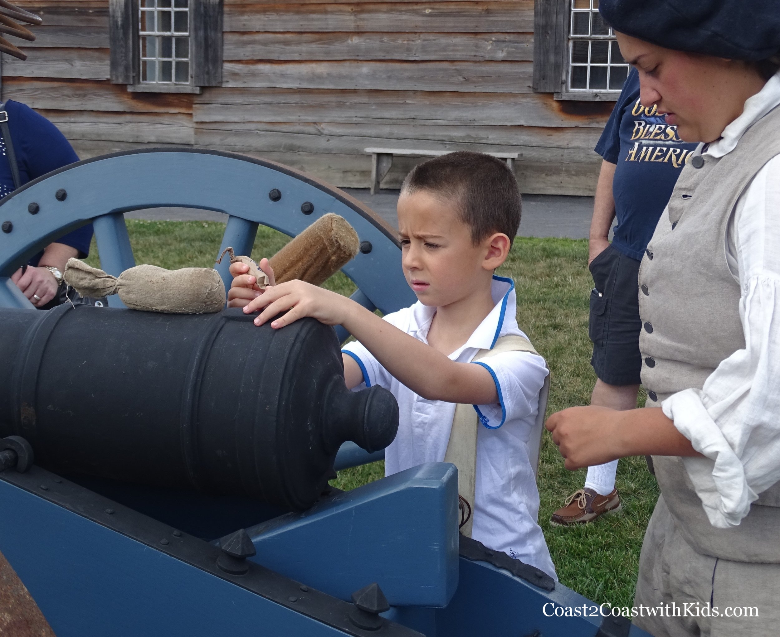 """My son had the important job of """"loading"""" the powder inside the cannon."""