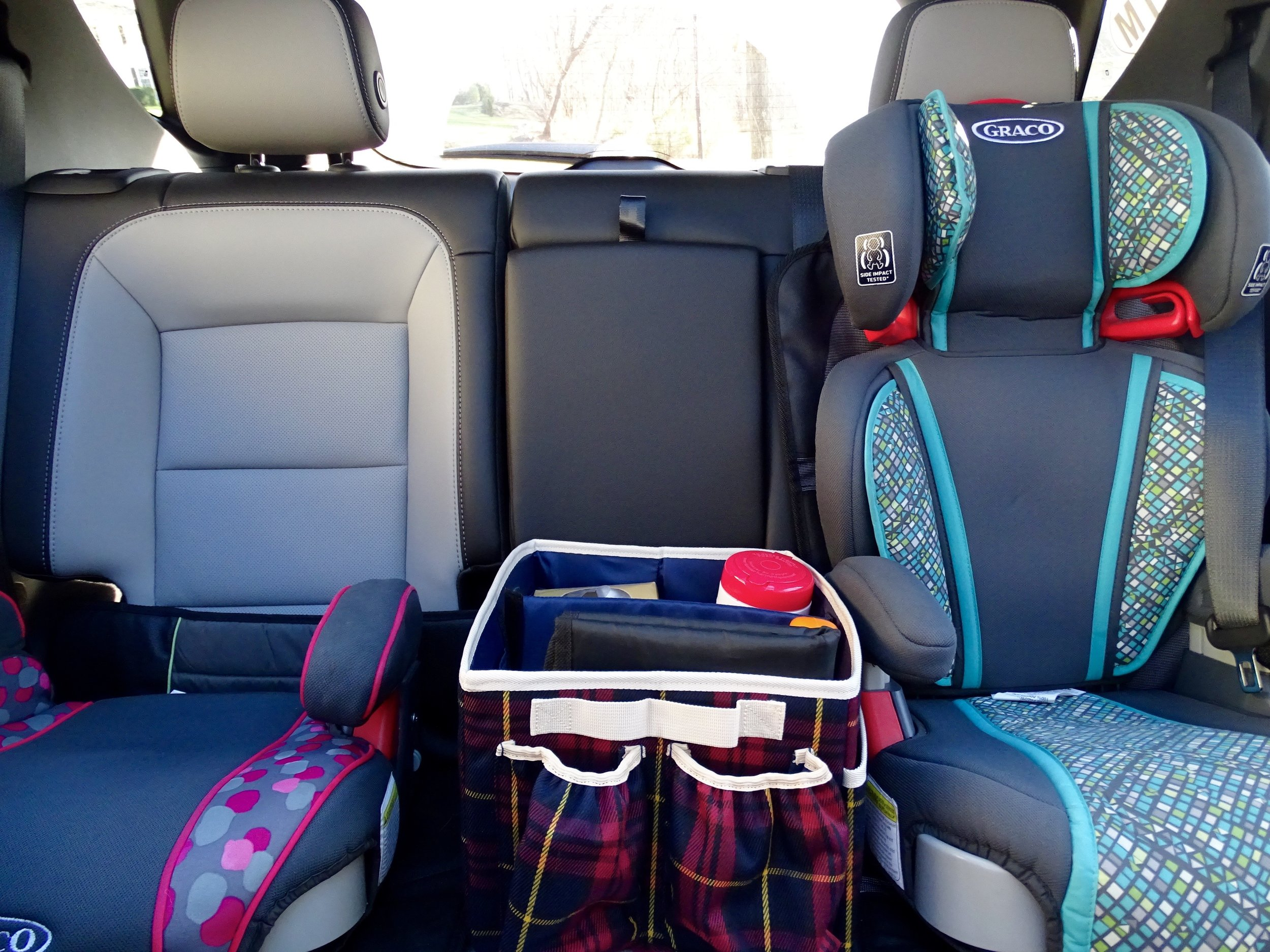 I keep our car organizer stocked with tissues, wipes, a first aid kit, and sunscreen.