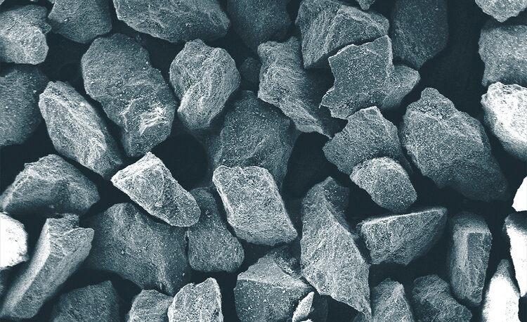 Scanning electron microscope (SEM) image of Himed's proprietary MCD apatitic abrasive. Formulated to be as hard as possible (approximately 500 HV100) this bioresorbable abrasive presented a radical improvement over conventional alumina and silicon carbide methods for all manner of implant texturing.