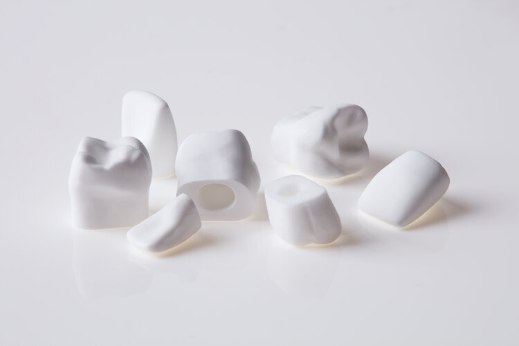 Cast hydroxyapatite teeth of various types with mounting holes to allow for placement in arrangements that mimic the human mouth. Himed casts numerous forms out of various calcium phosphate materials to aid researchers in both public and private sectors.