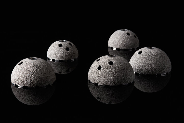 Acetabular cups, which are part of total hip replacement, showing Himed's patented porous MATRIX Ti™ surface coating — a highly cost-effective alternative to vacuum-applied titanium.
