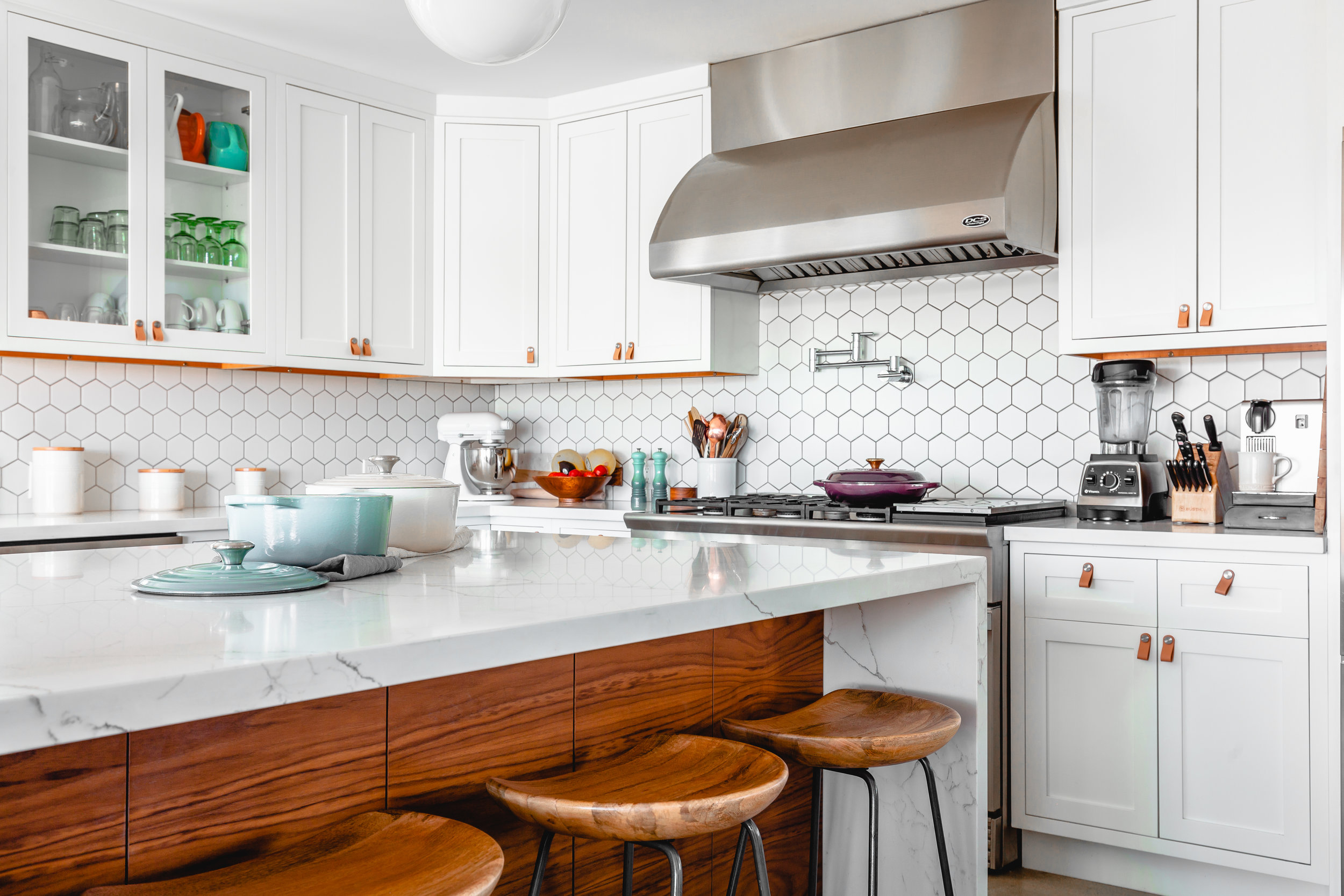 My daily routine includes making the most important meal of the day, breakfast. What's your routine? White and brown kitchen with center island, stools, and items sitting on counters. Photo by Unsplash