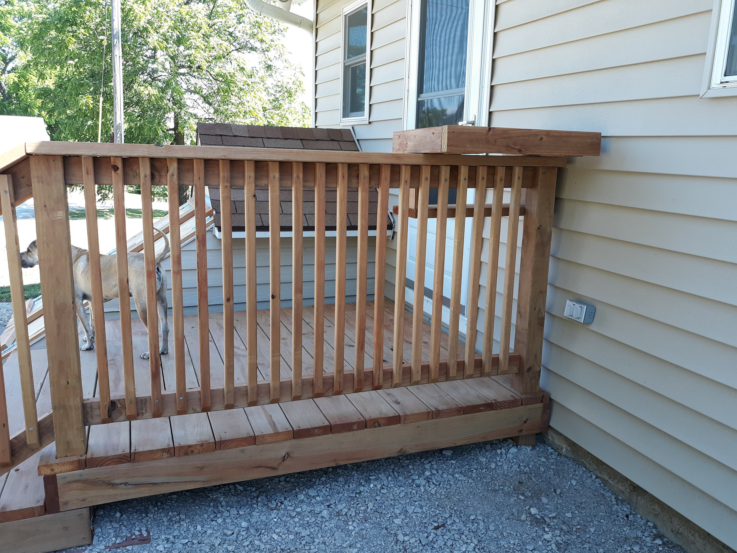 Photo of the rail and balusters on the new stoop.