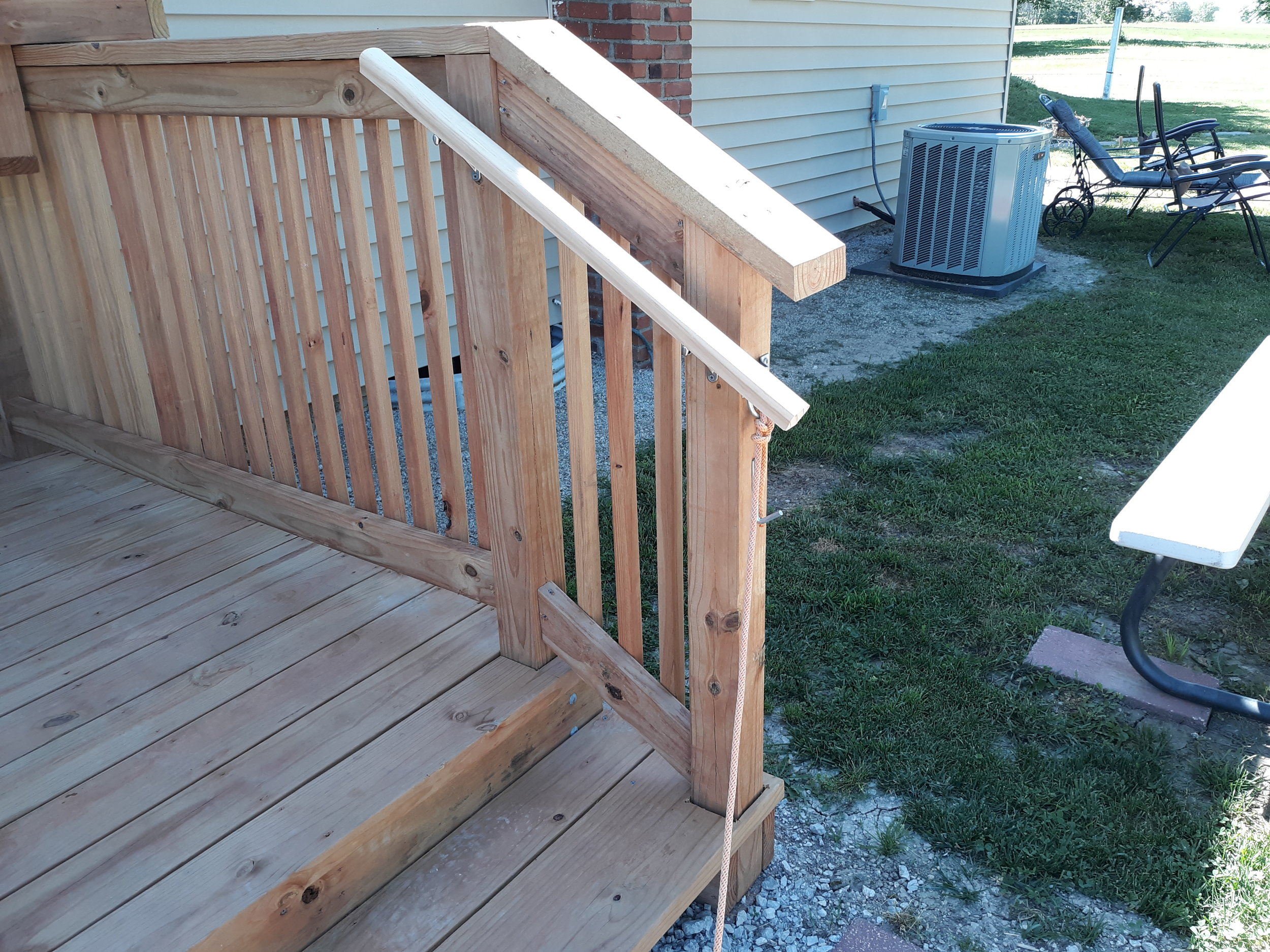 Photo of the rail and handrail on the new stoop.