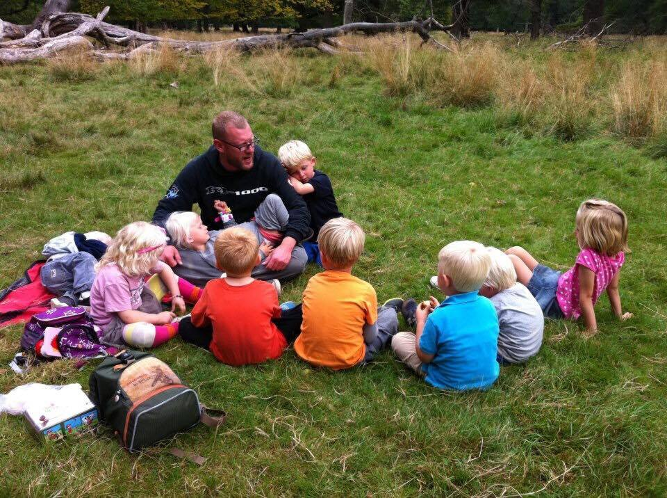 Karl Michael with kids from his Danish forest kindergarten.