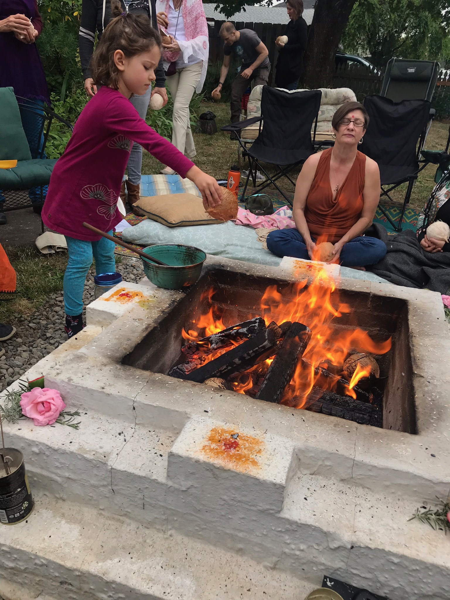 Summer Solstice Sacred Peace Fire 2018. Breaking coconuts and giving them to the fire.