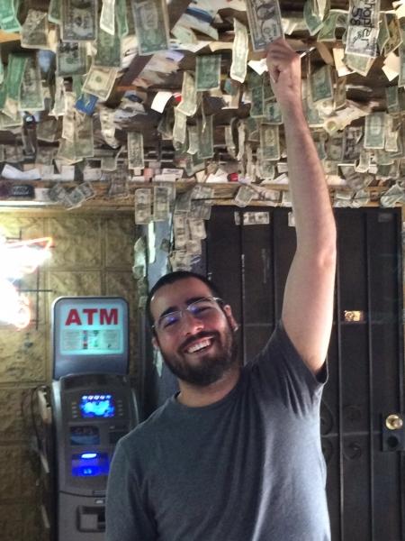 Felipe grabbing for dollars at Greasewood Flat  11-1-14