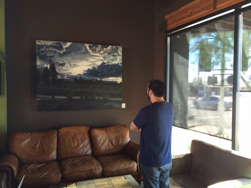 Felipe viewing a painting by Ben Peck (Onloaded 2), Echo Coffee  11-1-14