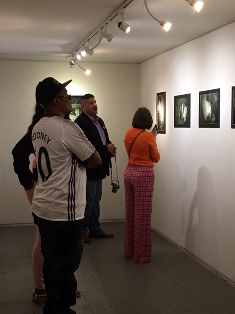 Ruben-Martel-with-exhibition-visitors-Third-Friday-10-21-16.JPG