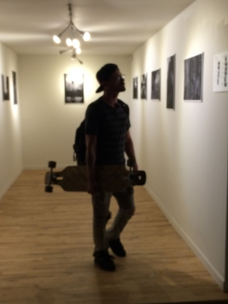 Skate boarder engaged with Wanderson's photos, Phoenix First Friday, 11-7-14