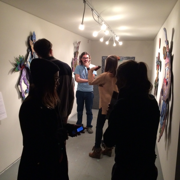 Dain speaking to visitors at Opening, 11-21-14
