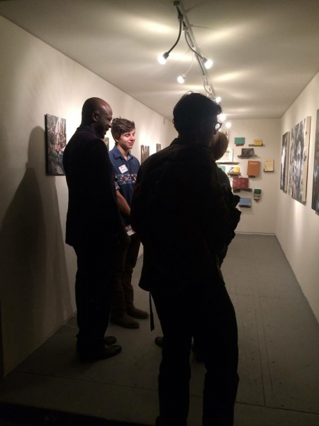 People enjoying Ben's exhibit on opening night, 2-20-15