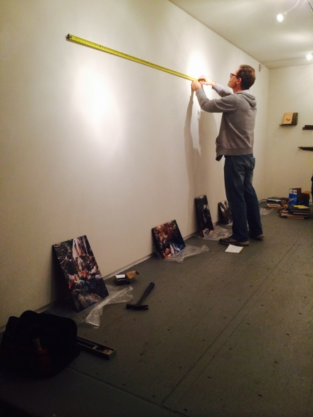 Brent Bond measuring during the exhibit installation, 2-19-15