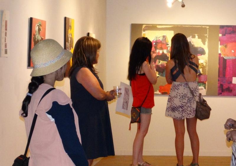 People enjoying Najelaa's paintings. Third Friday, 3-20-15. photo credit - Falah Alsaidi