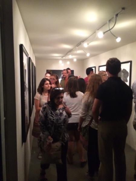 Art patrons enjoying Rigo's art works, First Friday, 4-3-15. Photo credit - Ted Decker