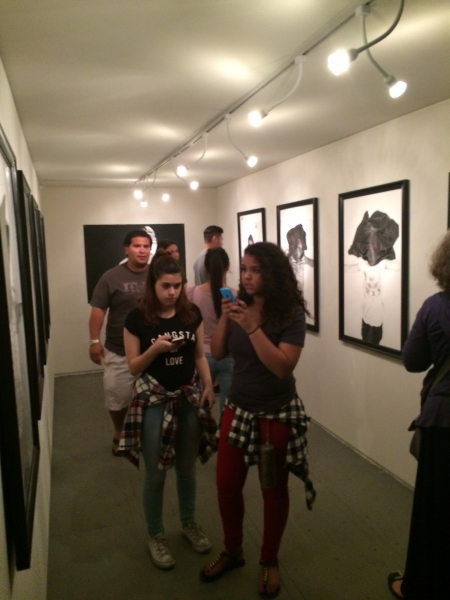 People enjoying Rigo's drawings, First Friday, 4-3-15. Photo credit - Ted Decker