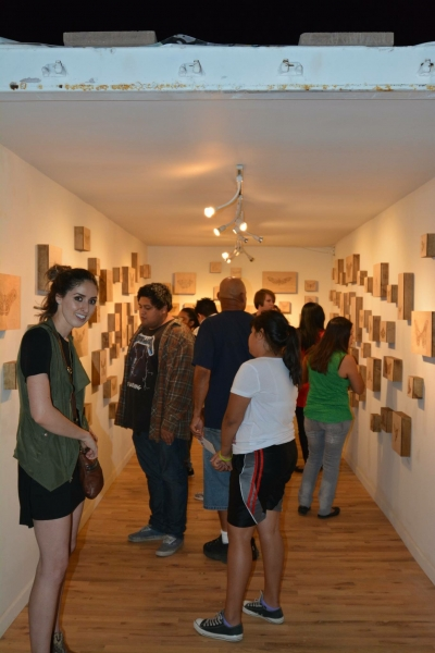 Art patrons viewing Lexie's exhibit, First Friday, 5-1-15. Photo credit - Salman Alwastey