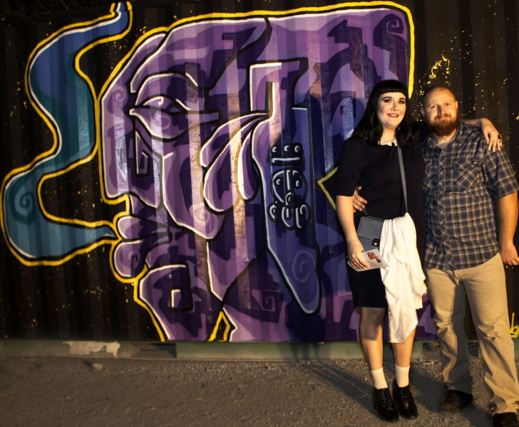 Kelsey Duff and Cory Slawson in front of Edgar's mural, Third Friday, 10-16-15. Photo credit - Ted Decker