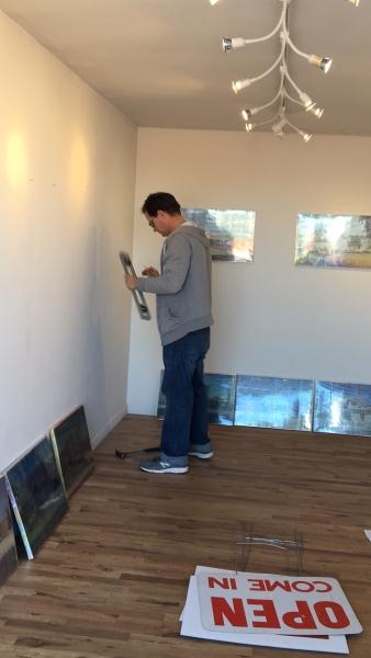 Brent Bond installing Bob Adams Onloaded exhibition, 1-16