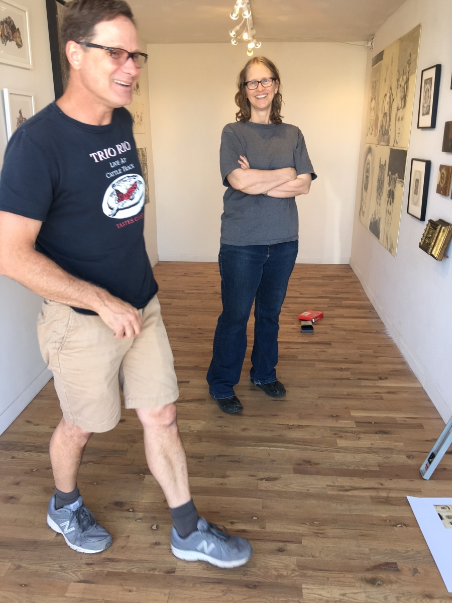 Brent Bond assisting Carolyn Lavender with the installation of her exhibition, 3-16-16
