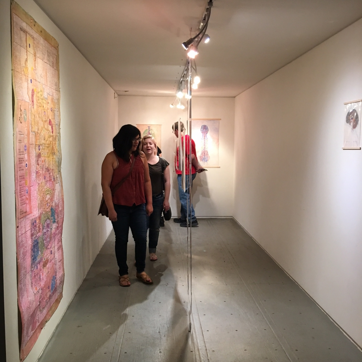 Monica Aissa Martinez, Cella, Third Friday exhibition opening with visitors, 3-18-16Photo credit: Ted Decker