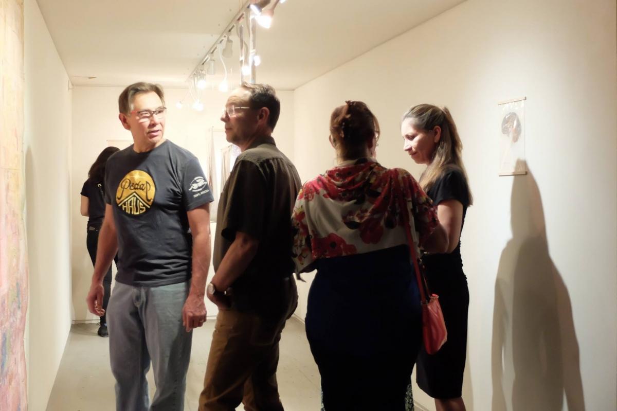 Viewers to Monica Aissa Martinez's exhibit, 3-18-16. Photo credit Salman Alwastey.Photo credit: Ted Decker