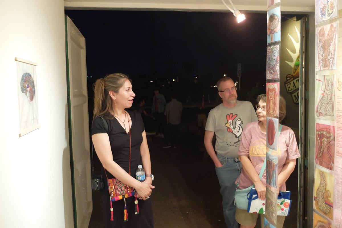 Visitors to Monica Aissa Martinez's exhibition, 3-17-16. Photo credit Salman Alwastey.Photo credit: Ted Decker