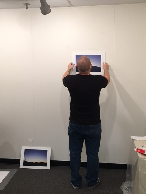 Cory Slawson measuring and installing the exhibition, 4-16-16