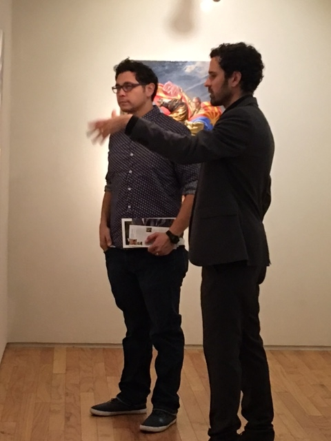 Darrin discussing his paintings with Larry Madrigal, showing in November with phICA, 10-21-16