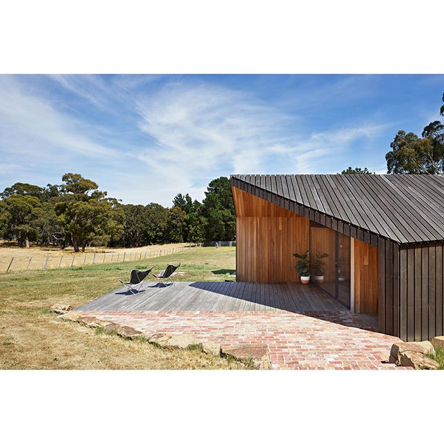 LIMERICK HOUSE • Set on a large plot of rural land, the existing house was insular and failed to respond to the expansive views of the surrounding landscape. The new addition sought to exploit these opportunities by increasing the dwellings connection with its surrounds. Two large steel doors serve in winter to frame the view of the undulating country hillside, whilst in summer they can be opened to allow the internal spaces to become an extension of the outdoor area. 🔨 @arc_design_build . 📸 @tatjanaplitt . . . . . . . #architecture #australianarchitecture #country #countryhouse #ruralarchitecture #australianhomes #architect #design #building #style #home #house #timber #wood #interiors #eganstown #daylesford #archdaily #archilovers #photooftheday #architecturephotography #instagood #architecture_hunter #finearchitecture #design_only #architects_need #solomontroup #solomontrouparchitects