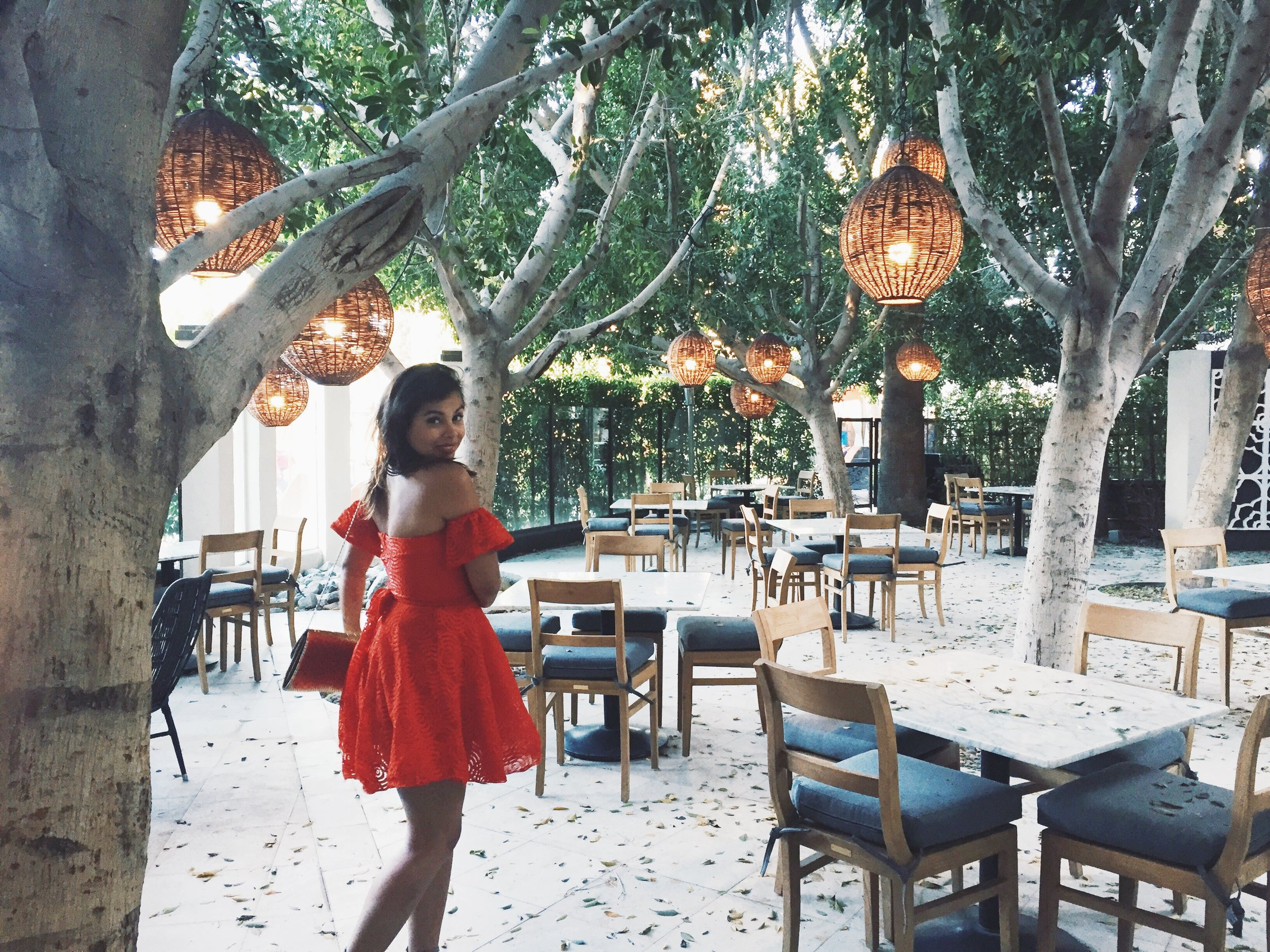 The Patio of Cantala and Cafe Palmetto. Dress:  Forever 21