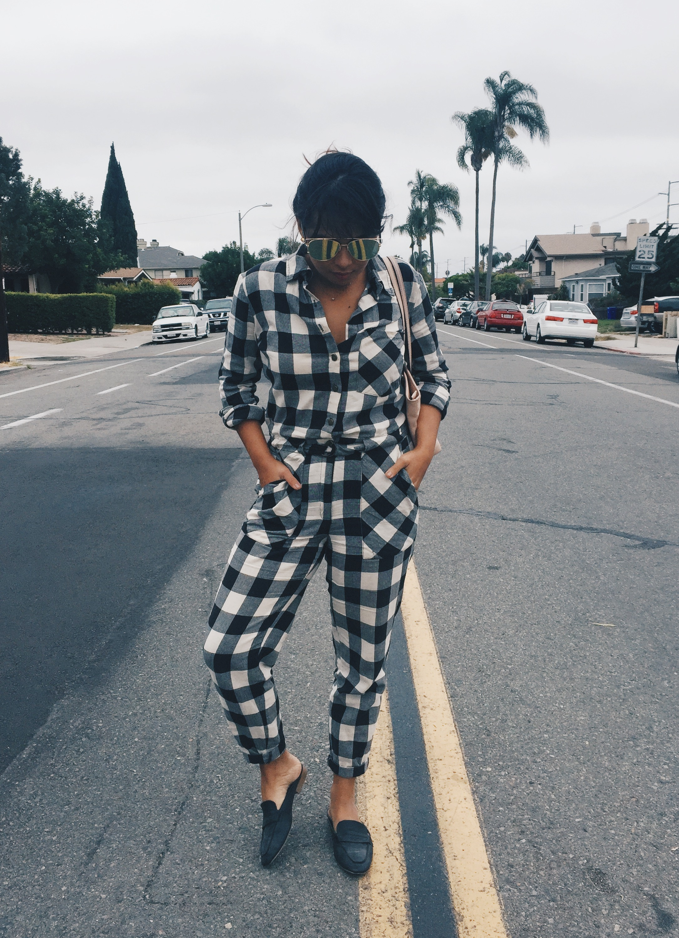 This jumpsuit is from Forever 21. I bought it over a year ago, but it's still available. Scroll down and you'll find it.