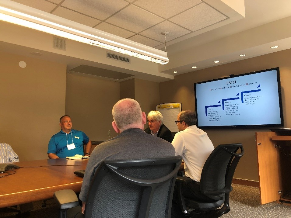In the boardroom, listening to Dr. Geoff Fernie and Ted Maulucci speak about the project