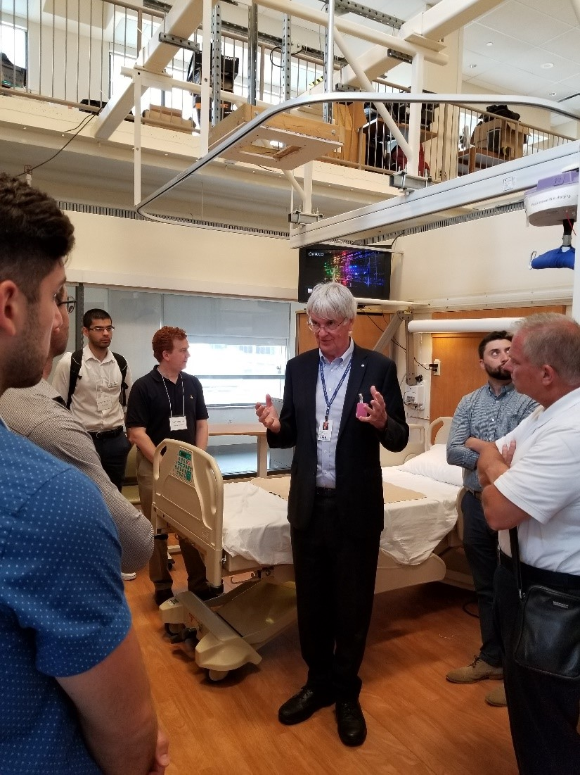 Dr. Geoff Fernie showing the group his hospital room simulator, used for the research and development of commercial healthcare innovations