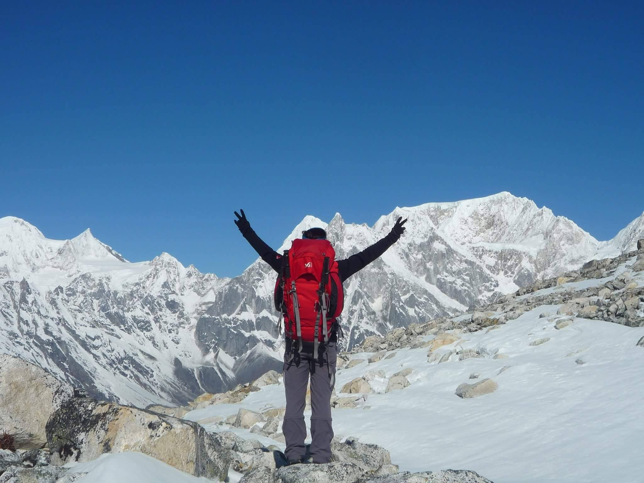 On top of Larkya La (5,125m/16,814ft) dramatic Himalayas towering peaks straight above you!