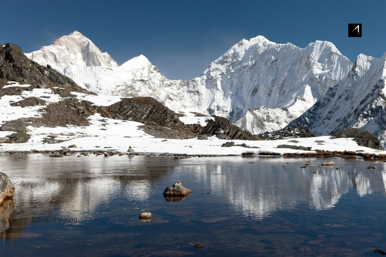 View of Mount Makalu mirroring in lake near Kongma La pass.jpg