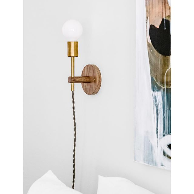 Preston Sconce in walnut and brass featured in a beautiful new home styled by @thefourthhouse for @guesthouseshop.  #interiordesign #interiorinspo #interiorproducts #madeinamerica #custommade #handcrafted #lighting #design #modern #studiomade