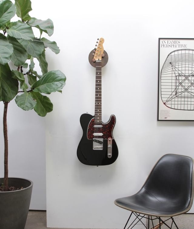 Our Hyla Lux Guitar Hanger is the highest end solution for displaying your axe. ⠀⠀⠀⠀⠀⠀⠀⠀⠀ ⠀⠀⠀⠀⠀⠀⠀⠀⠀ ⠀⠀⠀⠀⠀⠀⠀⠀⠀ #teletuesday  #interiordesign #interiorinspo #interiorproducts #madeinamerica #custommade #handcrafted #furniture #design #modern #studiomade