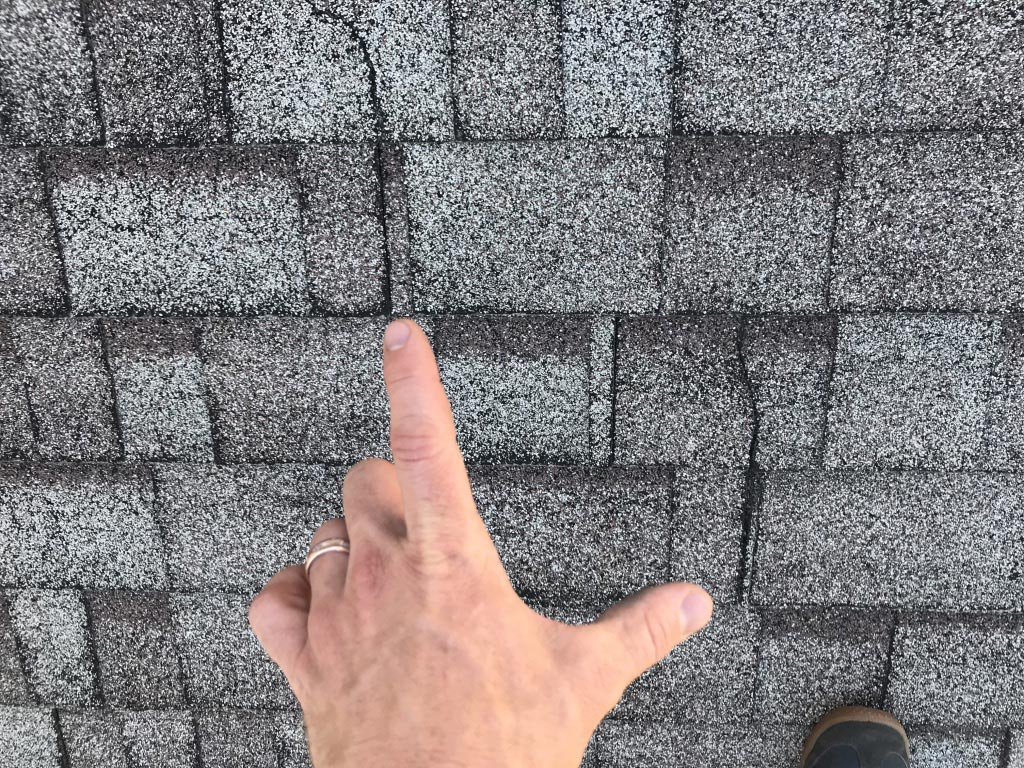 Cracked or missing shingles   These expose the roofing membrane underneath the shingle. That membrane is designed to be covered with shingles and may become damaged and leak when exposed.