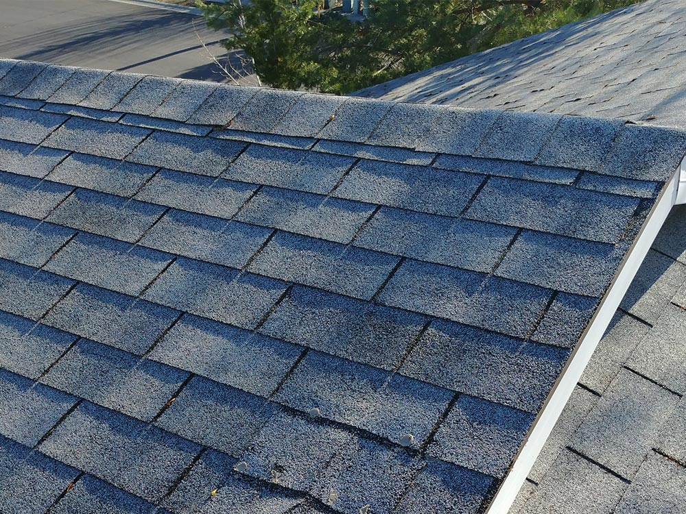 Above: Old and worn 3-tab shingles before a roof replacement.