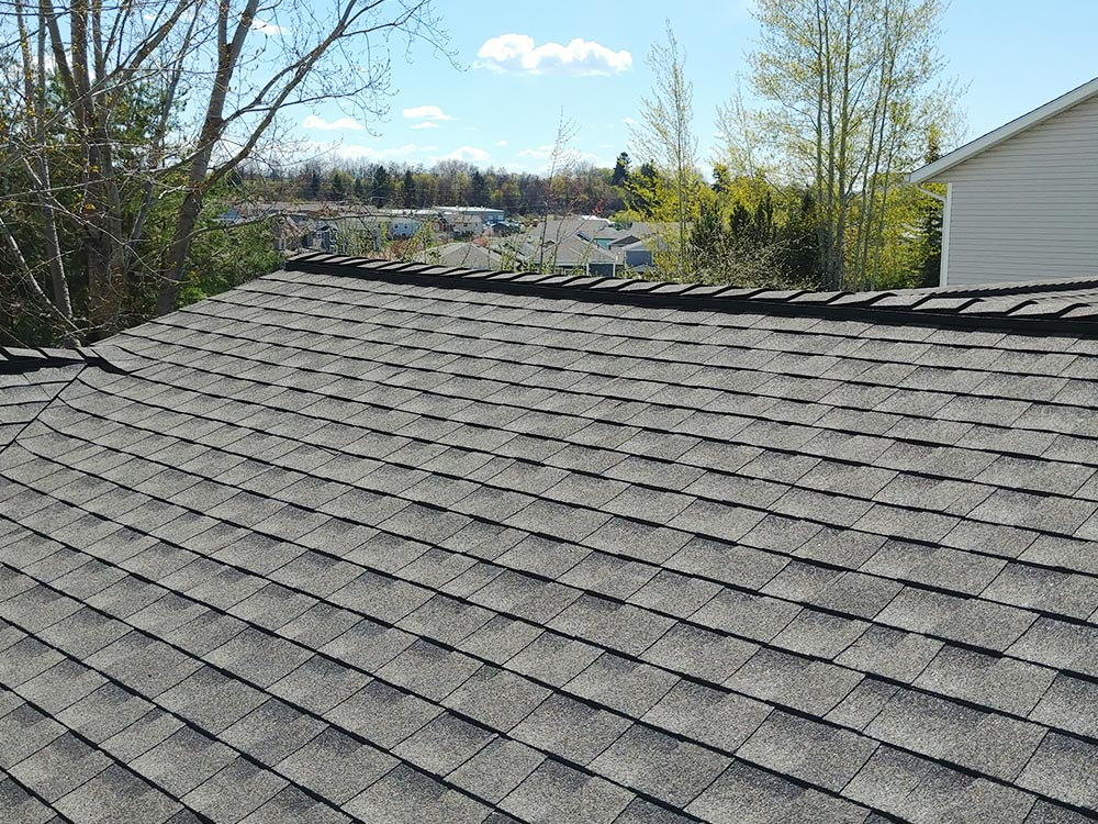 Above: New architectural shingles we installed on the same home.