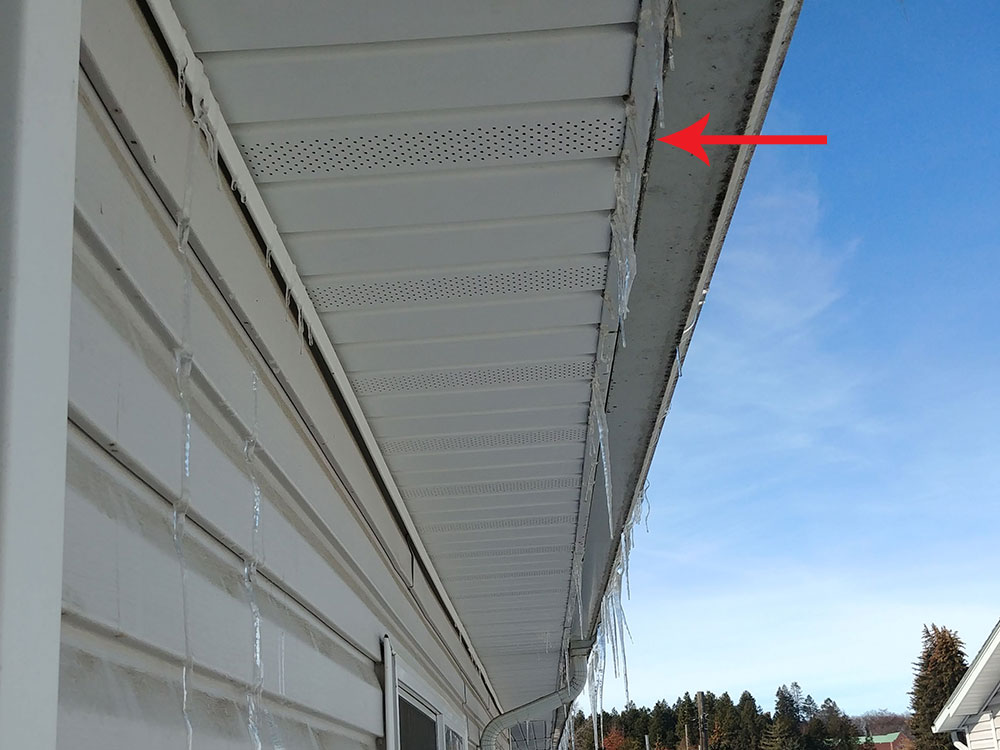 Water ran down between the gutter and fascia board before entering the soffit vent.